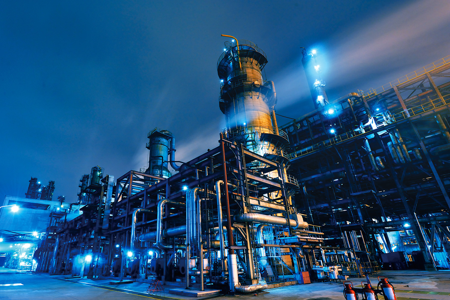 Oil Refinery, Chemical & Petrochemical plant abstract at night.