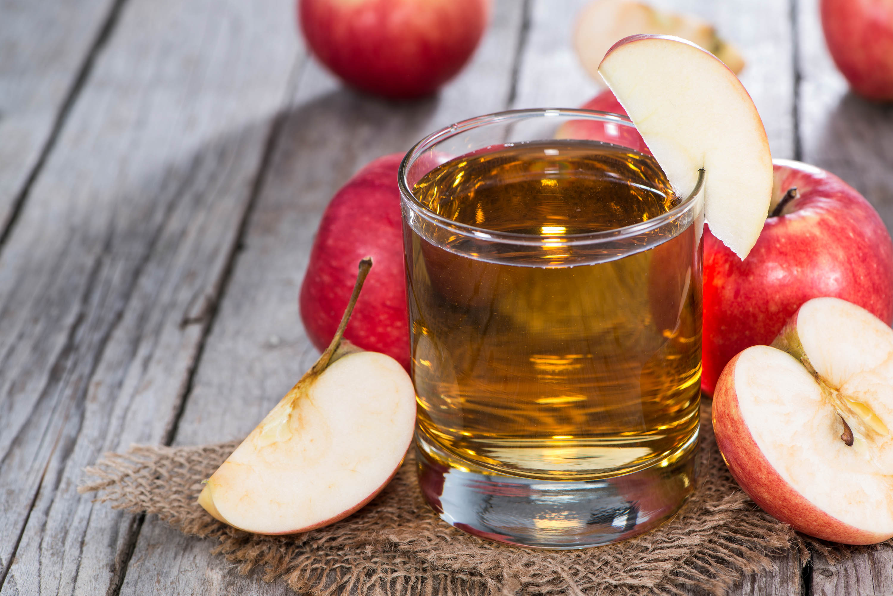 Apple Juice with fresh fruits on wooden background